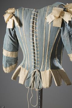Deeper meaning: Buried within the beauty of this intricate Rococo-era corset (circa 1770) ...