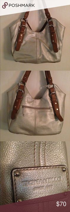 Beautiful silver Tignanello handbag EUC pebbled leather satchel w/ smooth leather straps. Inside silky lining, 3 sections, middle zips. Other zippered pockets on inside and outside. Tignanello Bags Satchels