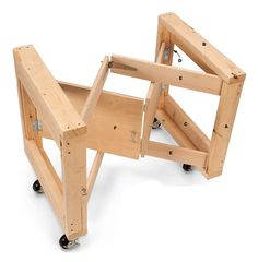 """Folding Table Base by Richard Ayers -- Homemade folding table base constructed from lumber, 3/4"""" plywood, hinges, latches, and casters. http://www.homemadetools.net/homemade-folding-table-base"""