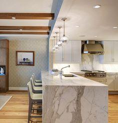Kitchen. Beach house kitchen. Kitchen barstools, beams, hardwood floors, marble island , overhead lighting, sleek kitchen design. W Design Interiors.