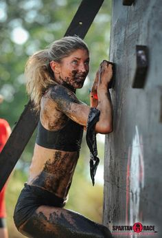 Girl climbing the wall at spartan race. Registered for the E-town event. What did I sign up for? OMG.