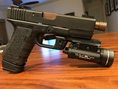 Glock 19 Gen 2. Mods include a Wheaton Arms trigger and copper threaded barrel, Truglow TFX Pro sights, stainless steel spring, NcStar tactical weaver rail adaptor, XGrip extended mag grip and Talon grips.