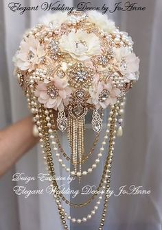 PINK AND GOLD CUSTOM BRIDAL BROOCH BOUQUET - $599.00 Total Price ____BROOCH BOUQUET DETAILS__________ Custom Vintage Inspired Draping Brooch Bouquet in soft Pink, Ivory and Gold. 9 Elegant Custom Designed Jeweled Wedding Bouquet is all handmade, very glam with a vintage flare. All