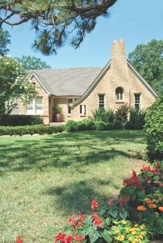1920s yellow-brick cottage with steep-pitched roof, Norman chimney, and fancifully shaped windows in Belhaven | Photo by Greg Campbell for Mississippi Magazine