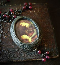Orpheus  Garnet Pictorial Shrine Pendant by ParrishRelics on Etsy, $88.00