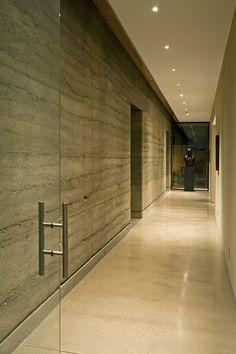 Rammed earth wall w/ preplanned doors w/ headers; Brent Kendie