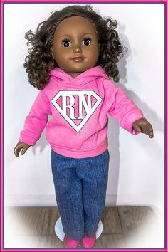 """This custom hoodie fits your child's 18 inch doll just like American Girl Doll Clothing. This outfit comes with custom logo work on the little 18"""" doll Hoodies and the sweatshirts are available to be purchased with sweatpants, denim jeans, or shorts (your choice). Then you can even add a pair of shoes or boots to complete the outfit for either your girl or boy doll! Boy doll clothes aren't easy to find, and these hoodies can be decorated with sports team logos or your favorite school or…"""