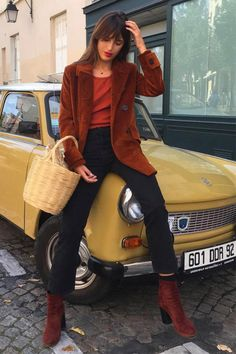 Jeanne Damas in a blazer, jeans, boots, and a Jane Birkin baset