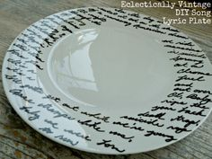 easy to make lyric plates. All you need is plate, Porcelain pen and masking tape. The Porcelain marker directions say to wait 24 hours for the plate to dry then bake it in the oven at 300 for 40 minutes.