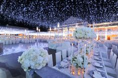 Twinkle lights over a black and white wedding theme.