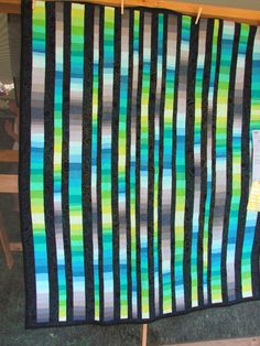 Color Strata - The Big One by Rob Appell at Sister OQS '14 -- I like this quilt but would really like to realign it horizontally and let the strata move more evenly. The interrupted sequences aren't working hard enough to hold my eye. Maybe I'll do that. The color-on-black is always very effective.