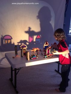 Shadow/Light Play with colored glass blocks, dinosaurs, natural wood blocks