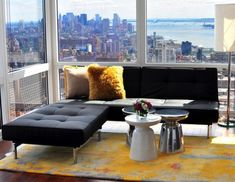 Here's a view of how to put a sectional in front of the large windows. ... having the extended end in front and the side with the back against the wall could work really well!  20 Amazing Living Rooms With Extraordinary View