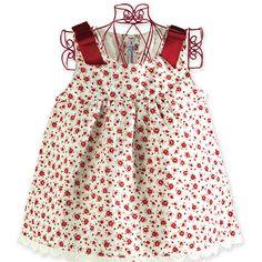 Vestido de florecitas y lazos rojos