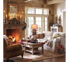 Living room idea for placement of furniture around fire place