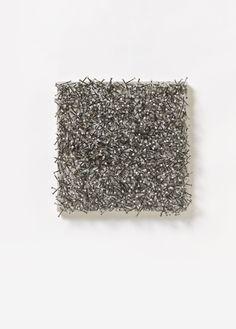 Günther Uecker, Verletztes Feld. Poesie der Destruktion, 1982  Nails and latex paint on canvas on wood. 40 x 40 x 8 cm