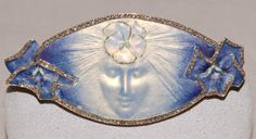"""""""La Pensee"""" enamel brooch by French artist René Lalique, circa 1900."""