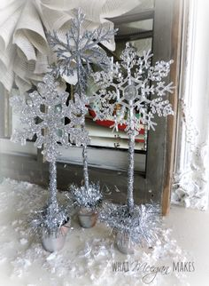 Topiary Snowflake Trio Topiaries are easy to make and a great Hostess gift for friends and neighbors. - Snowflake Trio Topiaries are easy to make and a great Hostess gift for friends and neighbors. Diy Christmas Snowflakes, Silver Christmas, Christmas Crafts, Christmas Decorations, Holiday Decor, Christmas Tree, Winter Wonderland Decorations, Winter Wonderland Birthday, Snowflake Centerpieces