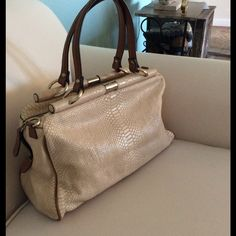 """Beautiful Etienne Aigner leather satchel handbag Color beige and brown, missing the shoulder strap , size 13""""x9.5""""x4"""" , strap drop 7"""" , the bag is in great condition, very elegant , 100% leather Etienne Aigner Bags Satchels"""