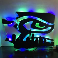Seattle Seahawks Skyline Sign Measurements: approximately 20.5 Wide, 14 High, 1.75 Deep LED lights are blue or green (see photos and please make your selection) So sorry the blue/green light combination is not available from my suppliers at this time. ***FREE SHIPPING to lower 48 states only*** This unique, one-of-a-kind sign is a great way to show off your team spirit with a 3-d effect created from using multiple layers of hand-carved wood. Eye-catching colorful copper wire LED light...