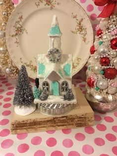 A personal favorite from my Etsy shop https://www.etsy.com/listing/554169858/blue-white-putz-church-glitter-village