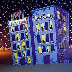 These Gangster Buildings features two buildings standing side by side and plays the sound of a trio of saxophones playing. Highlight your Roaring Twenties setting with these printed cardboard buildings. Each appears as two however it is actually one scene measuring 9 ft 2 inches high x 9 ft 8 inches wide. Assembly required.
