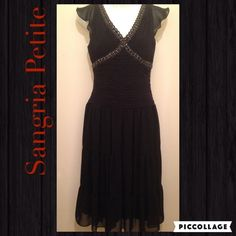 Sangria Petite LBD Beautiful Preloved dress in Black. Embellished v neckline. Pleaded and cinched waist. Hidden zipper on the side. Lined.  Please ask for measurements if needed, that way we can have a pleasant transaction.  •Love to Bundle & Take reasonable offers.  •Pet & Smoke Free Home.  Thanks! #lakaren77 Sangria Dresses Midi