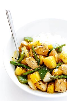 This Pineapple Ginger Chicken Stir-Fry takes about 20 minutes to make, and is full of the BEST fresh sweet and savory flavors.   gimmesomeoven.com