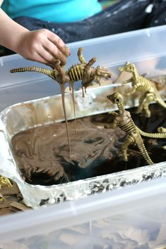 Simple Small Worlds: Dinosaurs and Sticky Mud - Sticky mud is simple to make, using cornstarch and water. Add a few dinosaurs for hours of imaginative play. The best part is that sticky mud rinses off easily and is great for both indoor and outdoor play. Dinosaurs Preschool, Dinosaur Activities, Sensory Activities, Preschool Activities, Dinosaur Projects, Dinosaur Crafts, Party Activities, Preschool Classroom, Indoor Activities
