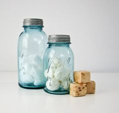 Vintage aqua mason jars with zinc tops...Mom canned in this type of jar.  I know she used the two quart jar to can her beef and tomato juice.