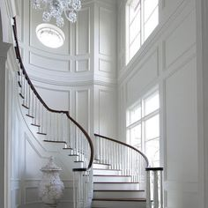 Unbelievable white entry foyer and curved staircase, fabulous trim. Maybe change the floor color n the wall for my entry n stairs Curved Staircase, Grand Staircase, Staircase Design, Staircase Ideas, White Staircase, Spiral Staircases, Modern Staircase, Staircase Molding, House Staircase