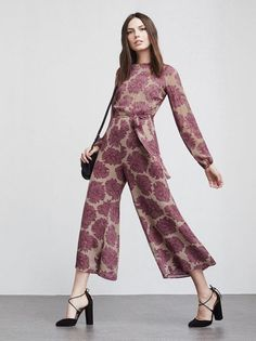A party jumpsuit is just as good as a party dress. The Felice Jumpsuit is a long sleeve georgette jumpsuit with a high neckline, fitted waist and cropped wide legs. The back has a little cutout and hook/zip closure. We also included a self belt in case you want to pull it in a bit more at the waist. https://www.thereformation.com/products/felice-jumpsuit-jaipur?utm_source=pinterest&utm_medium=organic&utm_campaign=PinterestOwnedPins