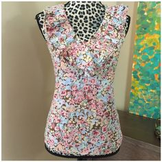 """Ralph Lauren Floral Tank w/ Ruffles at Collar Lauren Ralph Lauren Floral Tank w/ Two Layers of Ruffles at Collar --- size extra small --- 100% cotton --- very good used condition --- no stains, pulls, or loose threads --- 18"""" bust --- 24"""" length --- runs large, can fit a size small --- thank you for visiting my boutique and please feel free to ask any questions Ralph Lauren Tops Tank Tops"""