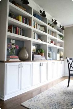 Use kitchen cabinets and IKEA butcher block counter tops to fake the look of built-ins. - Dream House - Library - Use kitchen cabinets and IKEA butcher block counter tops to fake the look of built-ins. Living Room Storage, Room Design, House, Home, Ikea Butcher Block, New Homes, Used Kitchen Cabinets, House Interior, Built In Cabinets
