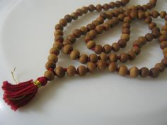 This mala is made from genuine naturally fragrant sandalwood and will never loose its aroma. Using the very best quality sandalwood, this mala features 6 mm beads and has been knitted in traditional styleTotal no. Rosary Necklace, Tassel Necklace, Necklaces, Prayer Beads, Surprise Gifts, Meditation, Handmade, Etsy, Knots
