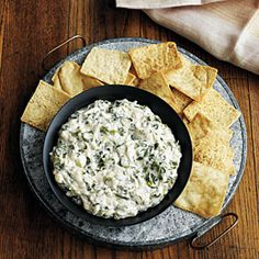Cheesy-Spinach Crab Dip | MyRecipes.com ~ This cheesy crab dip makes a savory party appetizer with minimal preparation time. Serve warm with pita chips or whole-grain crackers