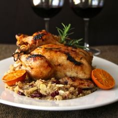 A darling of a dish for the holidays! Cornish Game Hens with Clementine Glaze and Cranberry - Almond Quinoa Pilaf.