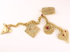 22k gold and 18k gold charm bracelet.  Rubies and diamonds too.