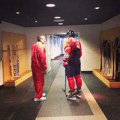 Asst. Coach Tim Hunter and Ovechkin talk before a scrimmage.