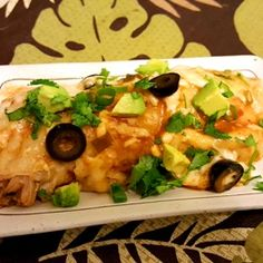 Easy Enchilada Created this easy chicken enchilada dish to share. Perfect for quick family meals or last minute potluck. I made this for myfamily last night and it was a hit. What seperates it from other similar dishes is that the combination of the two types of enchilada sauces. You can double the chicken and use it for next day tacos or nachos.I hope you enjoy