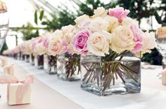 We want low centerpieces - ideally square glass vases with roses or another simple flower