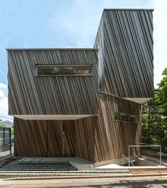 Kyodo House by Sandwich features a sculptural wood facade and an indoor swing.