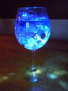 Wedding centerpieces; wine glass lights. Use our blue submersible tea lights for this. http://www.bluedottrading.com/led-tea-lights/submersible-led-tea-lights.html