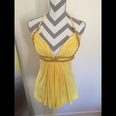 Sky yellow halter Top never worn Never worn with original tags!! Shirt is in perfect condition Sky Tops Blouses