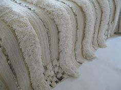 This elegant wedding blanket is perfect for a bed… soft & lush, mostly white with tiny cream stripes