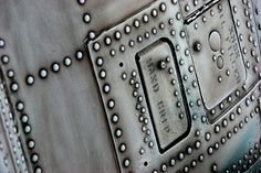 Fabricated metal with rivets.
