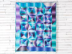 This modern jewel ombre quilt is available in my Etsy shop.  Jewel Quilt, Modern Quilt, Ombre Quilt, Lap Quilt, Twin Quilt, Quilts for Sale, Stripes, Throw, Bed Coverlet, Made to Order, Busy Hands Quilts.  purple aqua blue rainbow