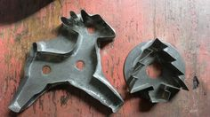 Two early tin Christmas cookie cutters. Reindeer is 7 inches wide.