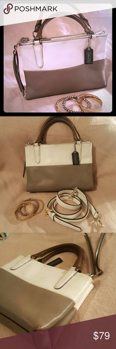 Coach medium Borough bag in taupe and white Gorgeous, stylish Coach bag! Three large zippered compartments, one has key clip and small pocket, another has large pocket and cell phone pocket. Cute tassels hang from 2 zippers. Does not have original crossbody strap, but will include brand new white, Michael Kors strap if you would like. A few very small light spots, could probably be professionally cleaned. Otherwise in excellent pre-owned condition!  BUNDLE & SAVE POSH RECOMMENDED SELLER…
