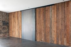 Amazing simplicity and texture. i love sliding industrial doors.